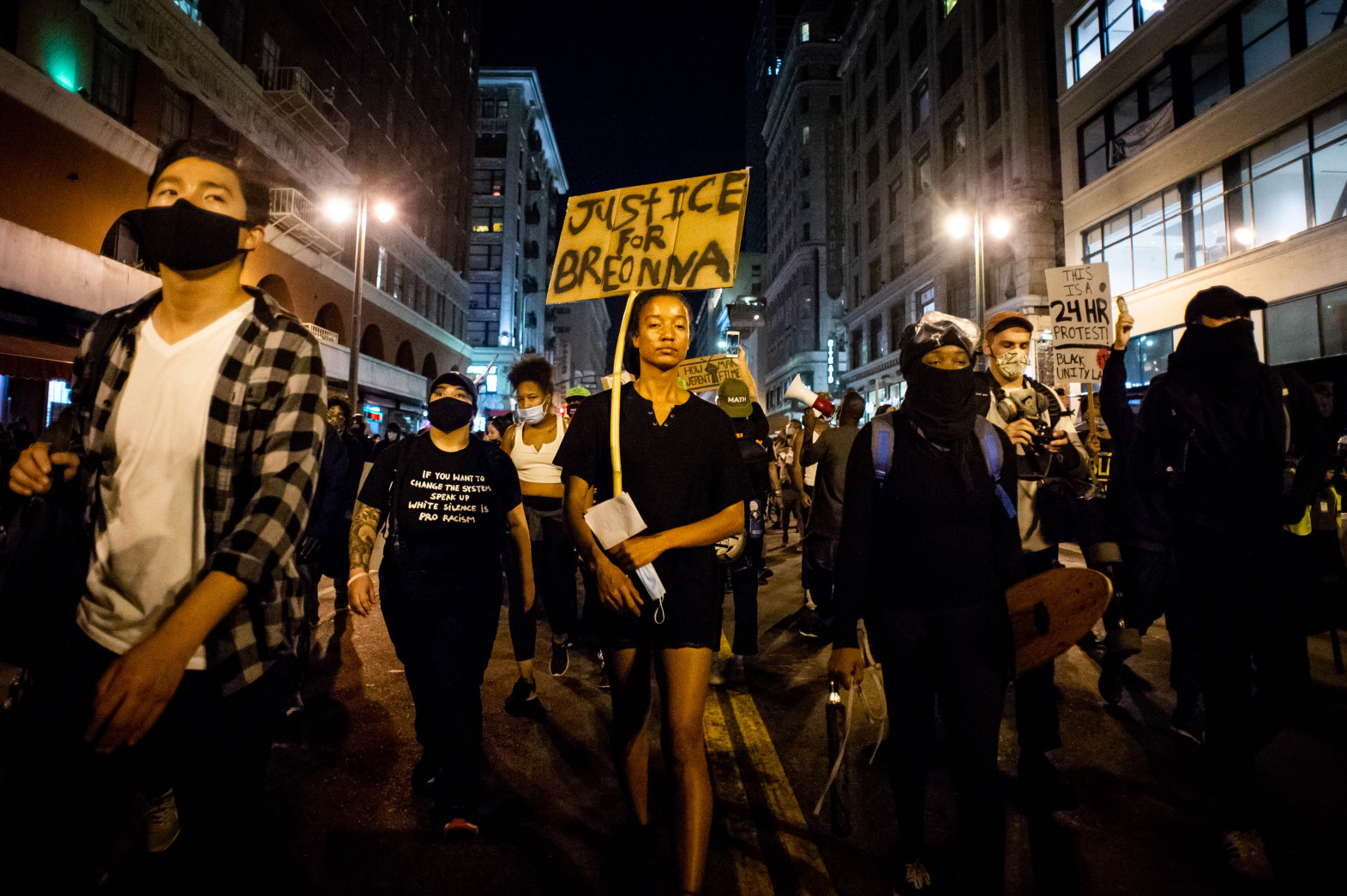 Demonstrators march through Downtown LA in protest of lack of charges in death of Breonna Taylor