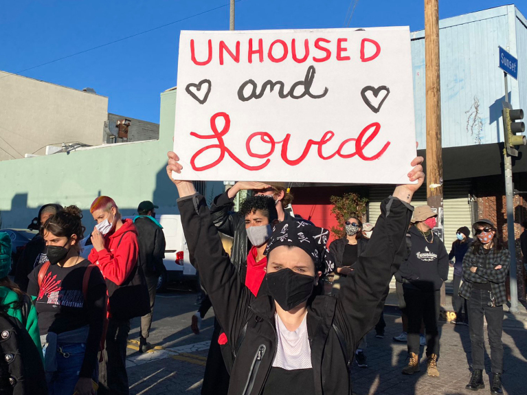 Hundreds pack Echo Park, protesting plan to shut area for refurbishment, force homeless to move