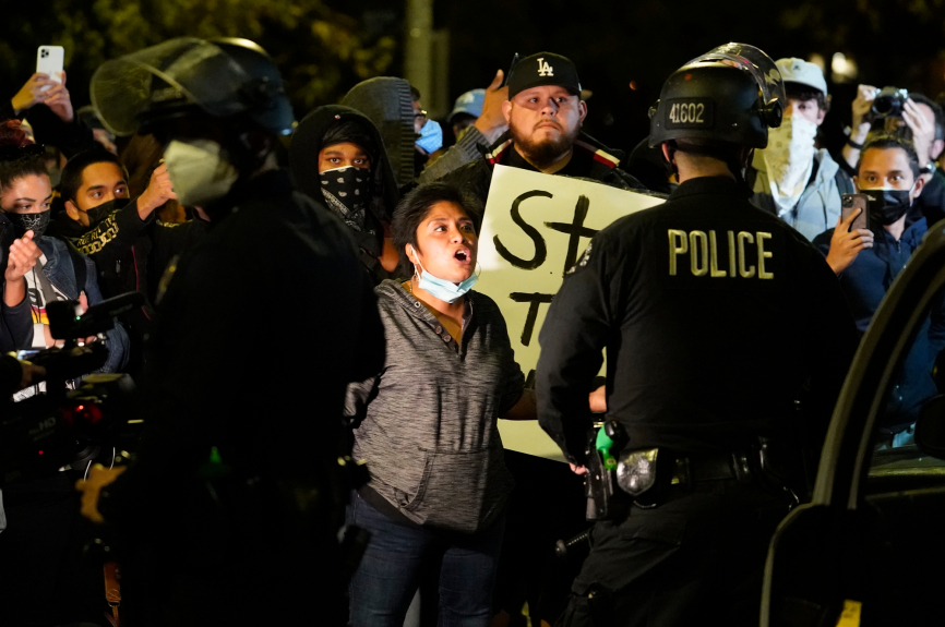 Police at Echo Park Lake homeless encampment face off with protesters