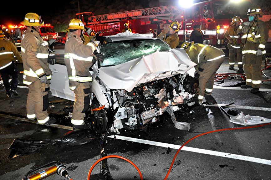 Sylmar crash kills woman, 57, injures two men