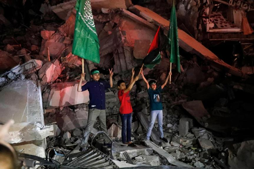 Palestinians see victory in Gaza truce as Israel warns Hamas