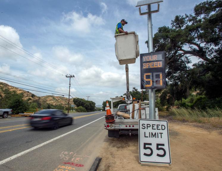 Those electronic speed signs are there to help you, not cite you