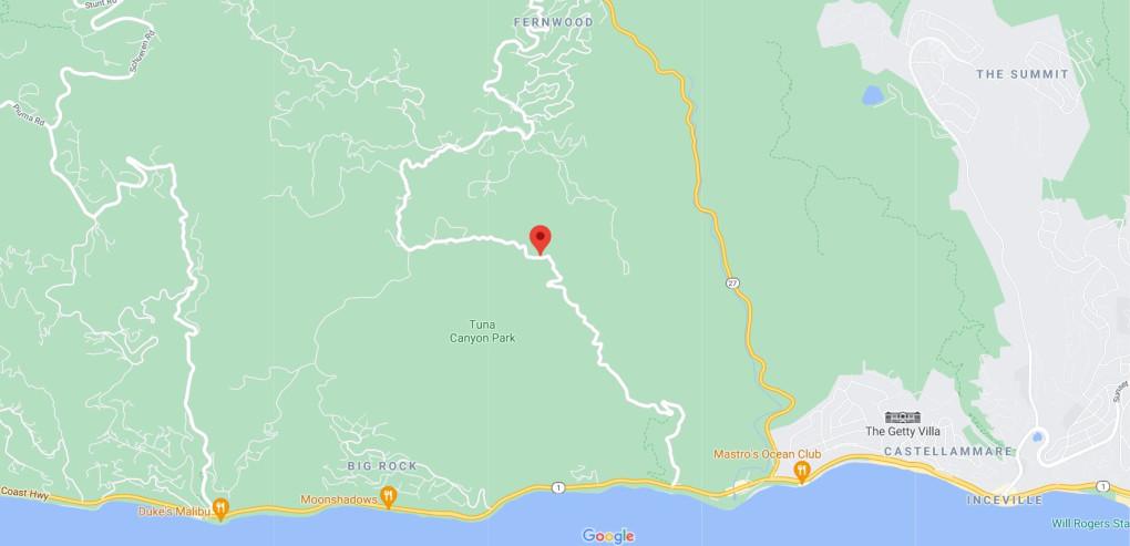 Brush fire burns in remote area of Malibu